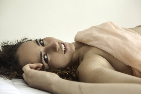 sensuous: portrait of beautiful woman lying down