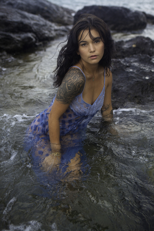 wet dress: woman in dress in the ocean Stock Photo