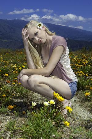 blond girl in field of flowers