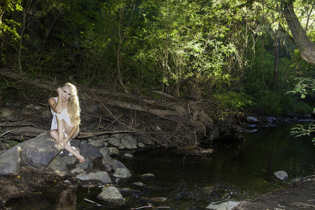 beautiful girl by a stream