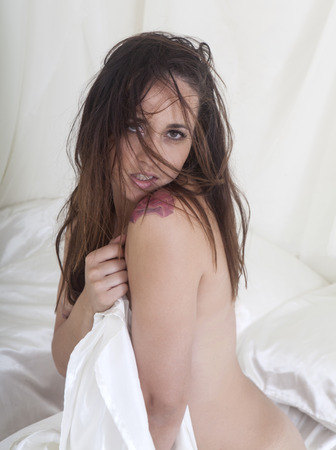 beautiful nude woman in bed