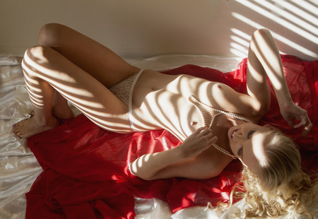 topless girl on red chiffon