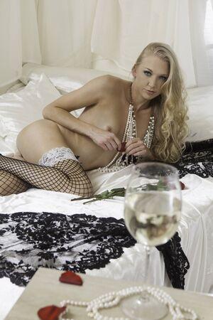 beautiful topless woman in bed