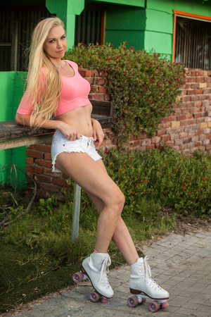 beautiful blond girl on roller skates at the beach