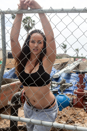 beautiful young woman at a construction site