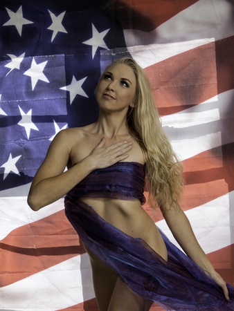 beautiful blond with the U.S. flag Stock Photo