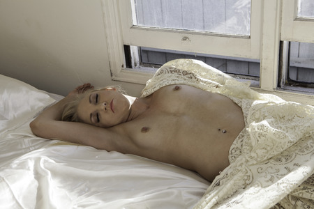 beautiful blond in her boudoir Stock Photo