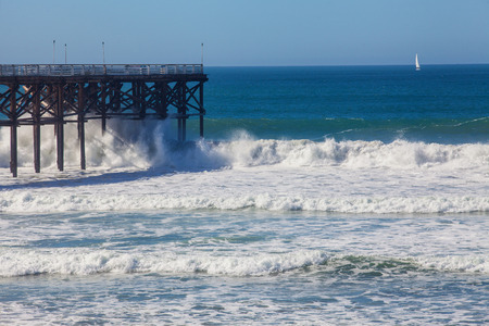 big surf at crystal pier in san diego