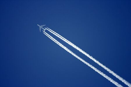 Aeroplane on the blue sky Stock Photo