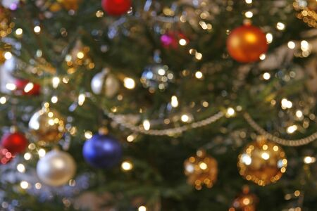 Blurred background from christmas tree with baubles and the lights