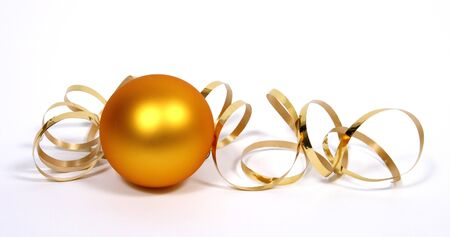 Yellow bauble with the gold ribbon on the white background