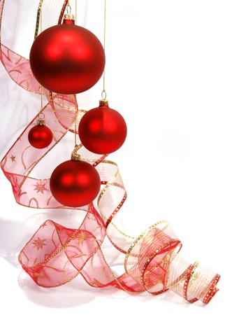 christmas bauble: Hanging red glass balls with the ribbon on the white background