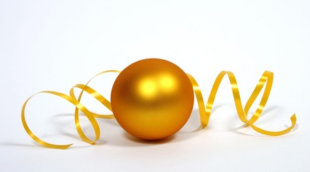 Yellow bauble with the yellow ribbon on the white background