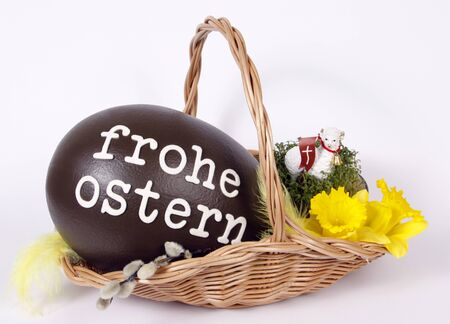 Ostern: Chocolate easter egg with text  Frohe ostern Stock Photo