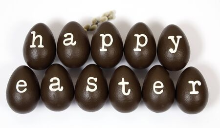 Chocolate easter eggs creating the inscription  Happy Easter Stock Photo