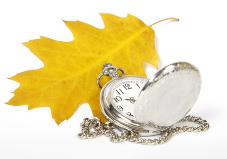 Yellow oak leaf and pocket watch on the white background