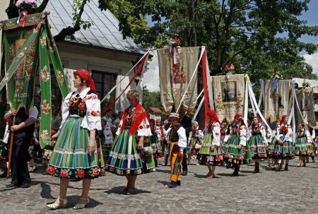 godly: Participants in the Corpus Christi procession, dressed in regional costumes on June 11, 2009 in Lowicz, Poland