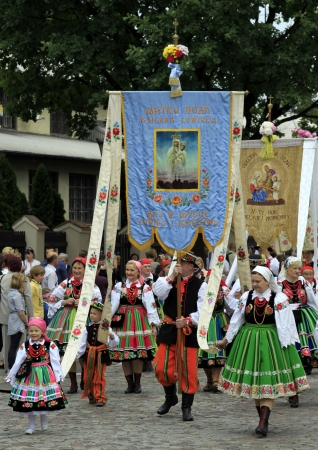 godly: Participants in the Corpus Christi procession, dressed in regional costumes on June 07, 2012 in Lowicz, Poland