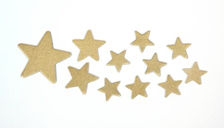Gold stars on the white backgroung Stock Photo