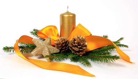 Christmas decoration with the yellow ribbon, cones and candle