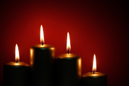 Four burning gold candle