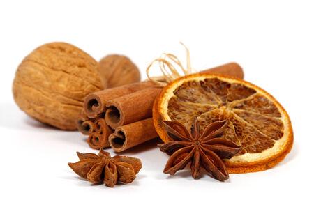 Christmas decoration  orange, anise, nuts and cinnamon;  Stock Photo