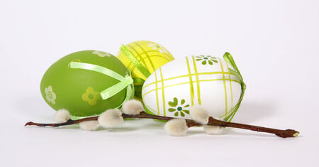 Three Easter painted eggs with twig of the willow