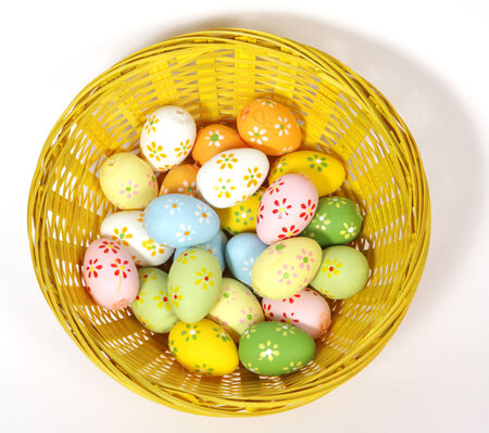 The yellow Easter basket with painted eggs  Stock Photo