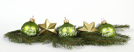 Green baubles and golden stars Stock Photo