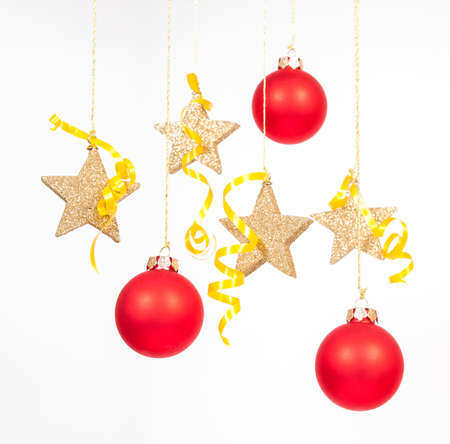 Hanging red glass balls with the stars on the white background