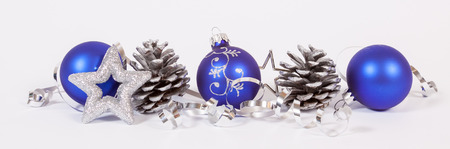 Baubles and cones with the ribbon on the white background Stock Photo