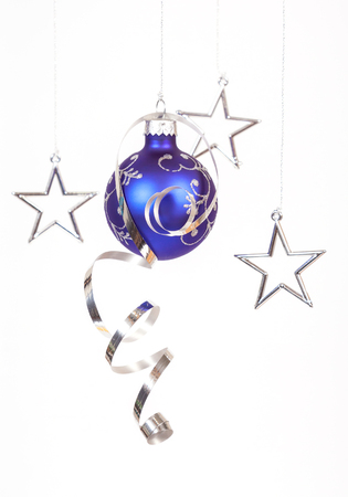 Blue bauble with the silvers star on the white background