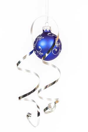 Blue bauble with the silver ribbon on the white background