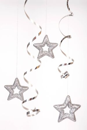 Silver stars with ribbon on the white background