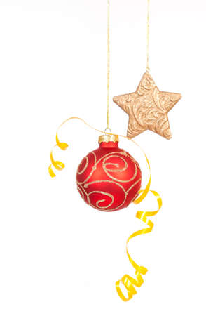 Hanging red glass ball with the star on the white background
