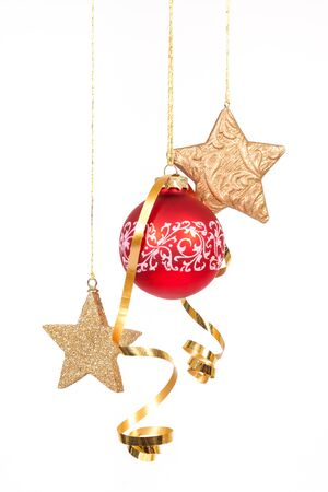 Hanging red glass ball with the stars on the white background