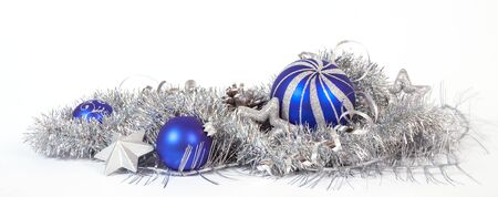 Christmas decoration with the blue baubles and silver stars Stock Photo