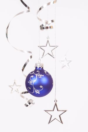 silver stars: Blue bauble with the silver stars on the white background Stock Photo