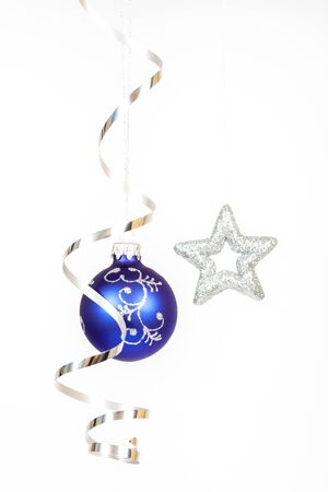 Blue bauble with the silver star on the white background