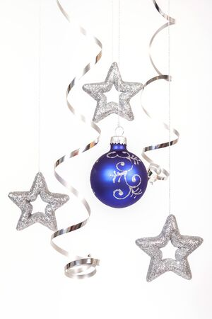 Blue bauble with the silver stars on the white background Stock Photo