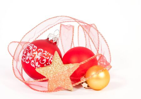 Red and gold baubles with the ribbon on the white background Stock Photo
