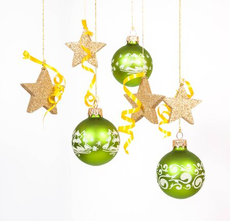 Hanging green glass balls and gold stars on the white background Stock Photo