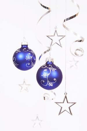 silver stars: Blue baubles with the silver stars on the white background
