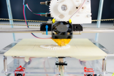 printing: Electronic three dimensional plastic printer during work in school laboratory.