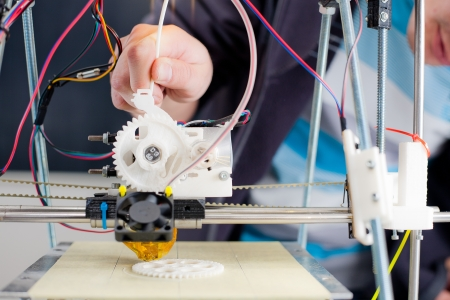 printing: Electronic three dimensional plastic printer during work in school laboratory  Stock Photo