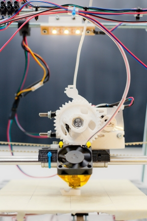 Electronic three dimensional plastic printer during work in school laboratory Stock Photo - 22747355