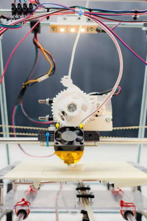 Electronic three dimensional plastic printer during work in school laboratory.