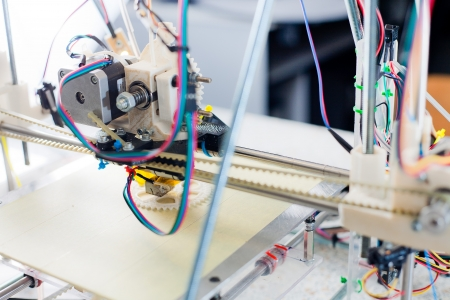 Electronic three dimensional plastic printer during work in school laboratory  Stock Photo