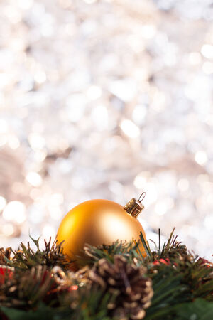 Christmas ball on wreath with abstract light background. Stock Photo