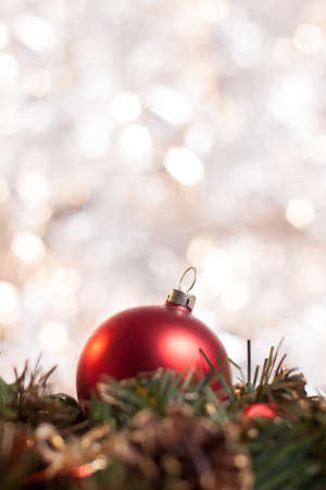 Christmas ball on wreath with abstract light background. Stock Photo - 22747410